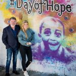 Pictured left to right is Comedian & actor Pat Shortt with daughter Lily proudly standing beside a colourful mural created by artist ADW for this #Dayof Hope event.
